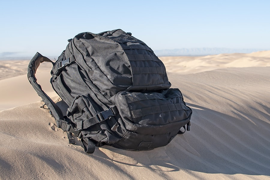 EDC Backpack full-loaded on sand