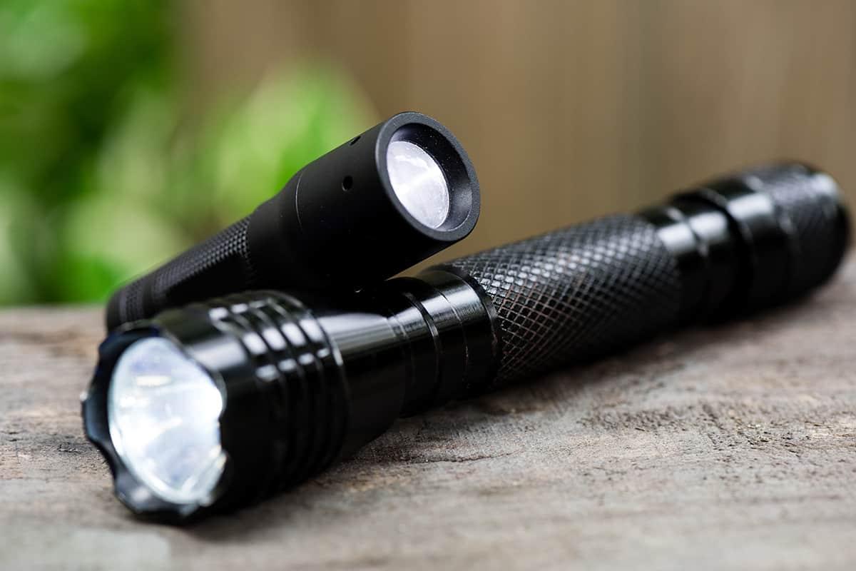 Flashlights lying on the wood ground