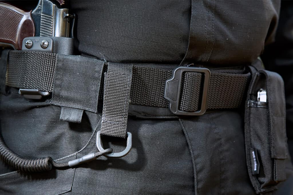 Officer wearing tactical belt with gun on the side