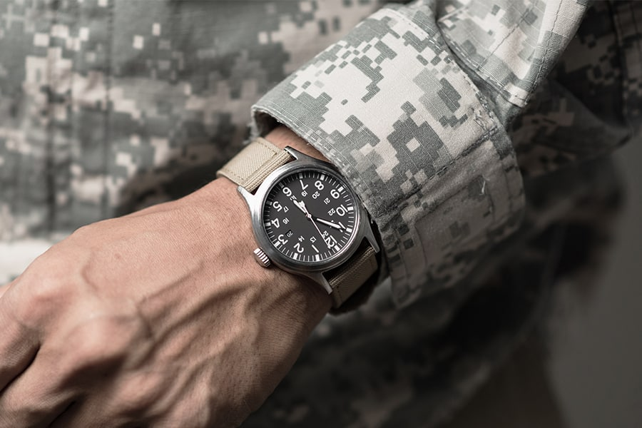 Military man wearing field watch