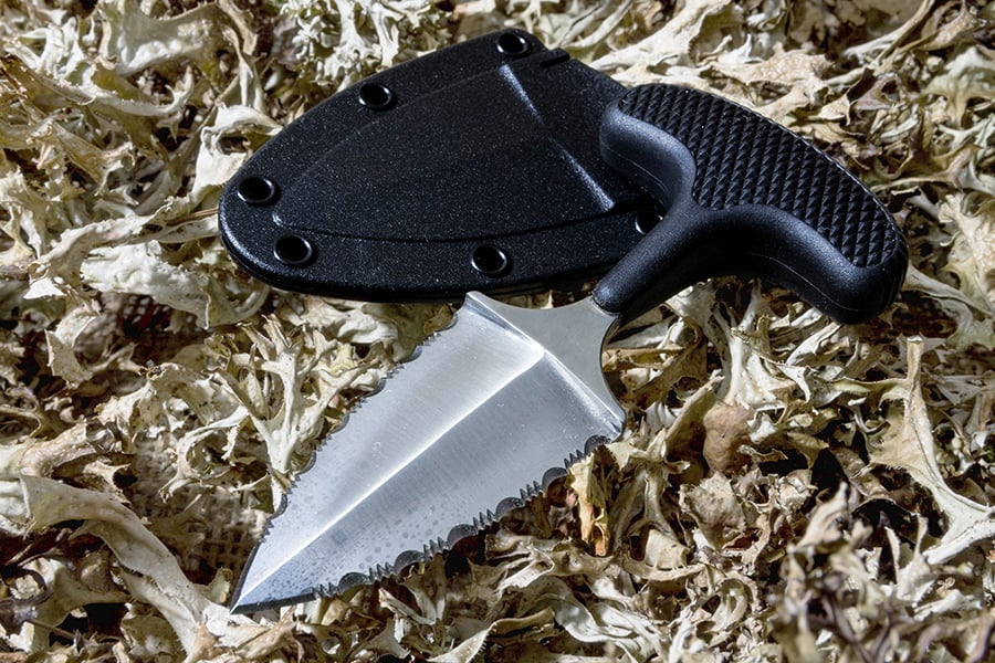Push dagger knife on the grass