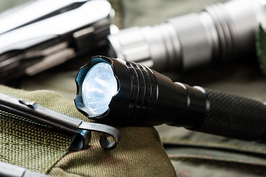 EDC tactical flashlight putting around gear