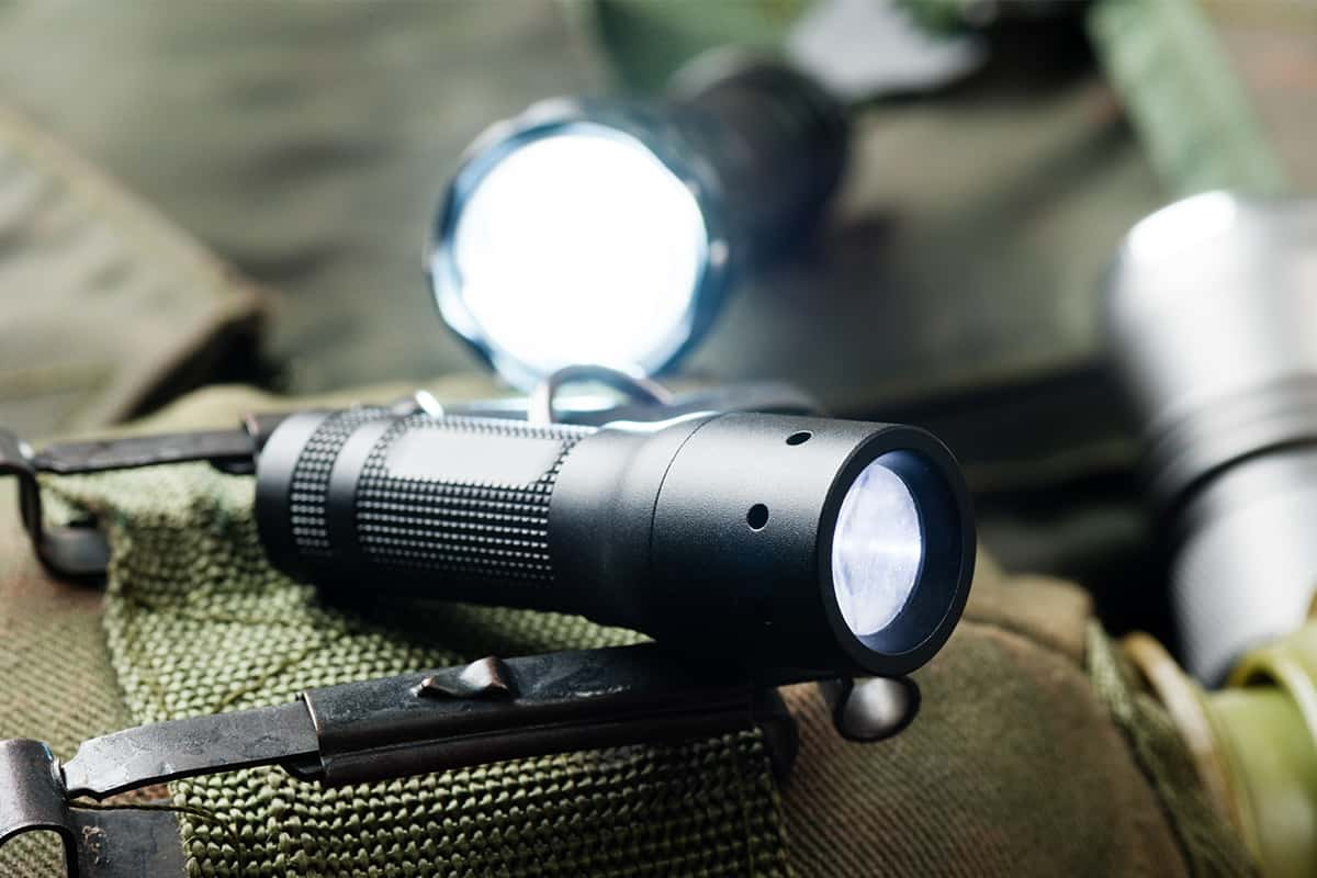 EDC flashlights on a tactical background